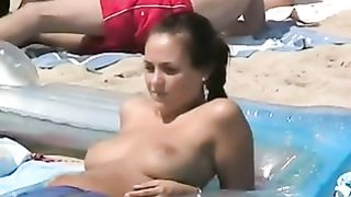 Cute topless chick takes sun bath on nude beach - hidden cam--_short_preview.mp4