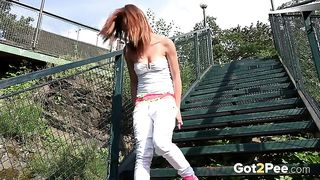 Cute redhead sporty babe pulls down her white pants and pees--_short_preview.mp4